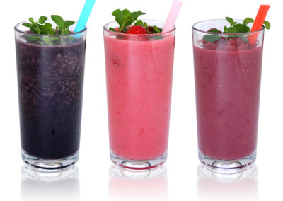 Smoothie Fruit Juice Milkshake With Fruits In A Row Isolated